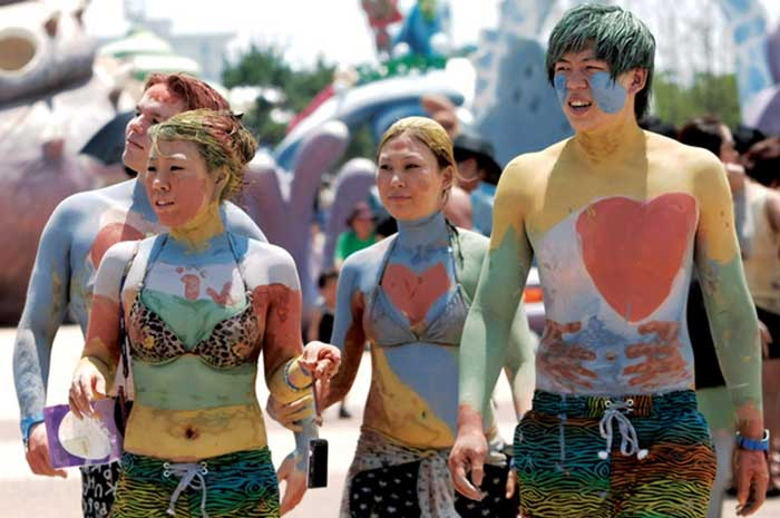 body paint with coloured mud