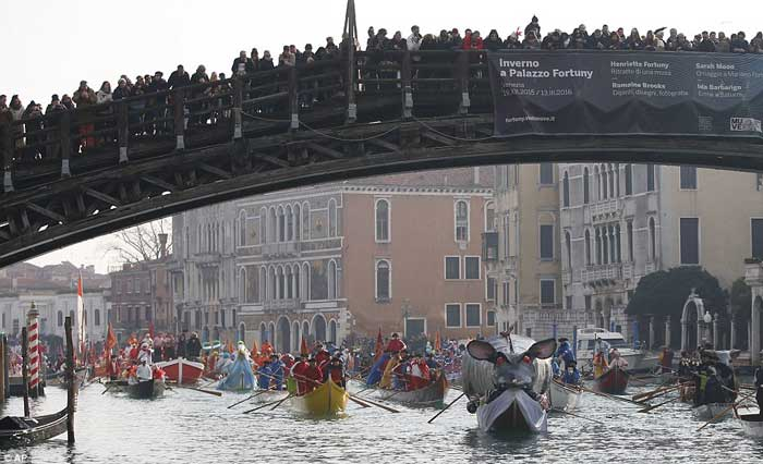 Boats sail under the Accademia Bridge