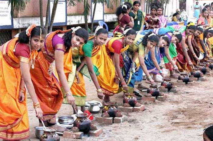 Young girls cooking Pongal Payasam