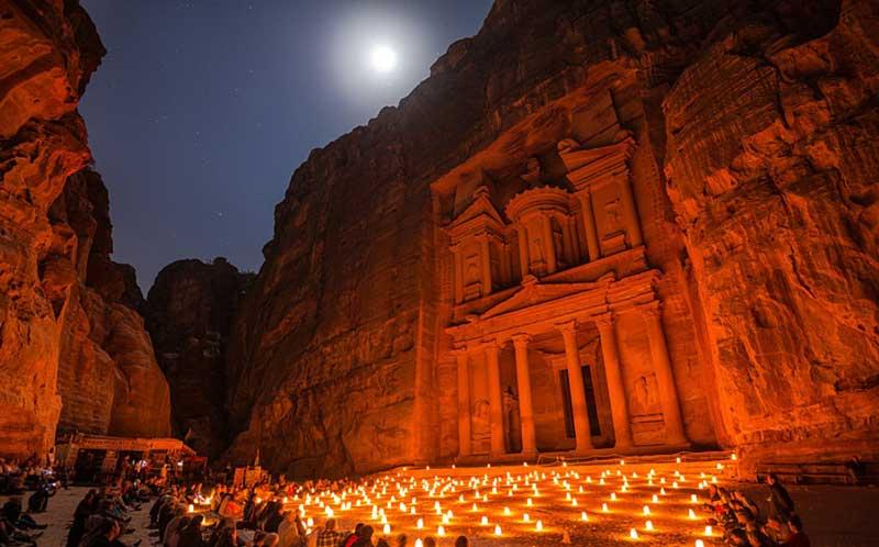 Candles and moonlight illuminate Al-Khazneh