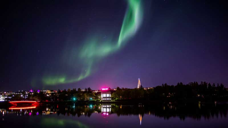Aurora Borealis over city of Reykjavik