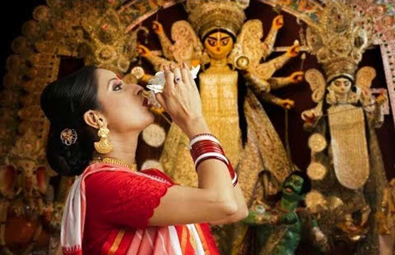 Durga Puja Playing a conch