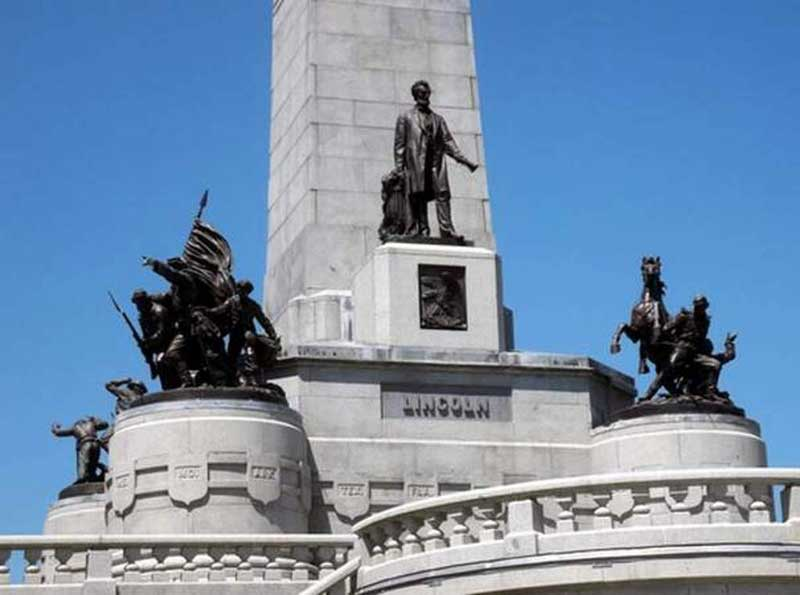 The Infantry and Cavalry statues at the corners of the obelisk.