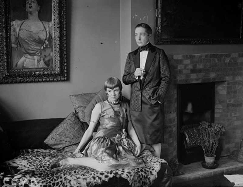 Radclyffe Hall as John (standing) and her partner Una