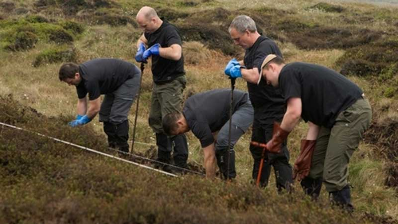 Searchers comb the Saddleworth Moor